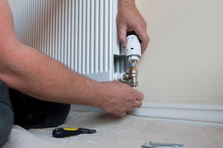 Man Fixing Heating System